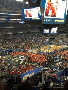 Senior Kevin Van Lieshout and dad Jim attend the Final Four game in Arlington, Texas, to support the University of Wisconsin Badgers, their favorite team. Despite Wisconsin's loss to Kentucky, the pair said they still had a great weekend. (Photo courtesy of Kevin Van Lieshout)